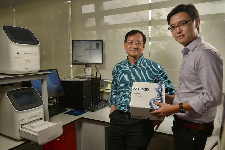 Dr Too (left) and Dr Zhou with their diagnostic kit.