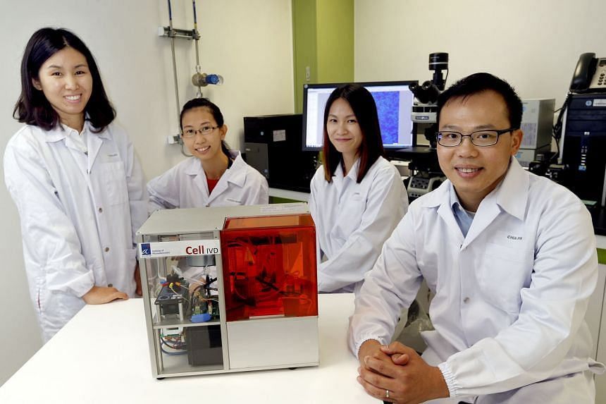 A*Star researchers (from left) Liu Yunxiao, Karen Wang, Chiam Su Yin and the lead researcher, Dr Chang, with the prenatal diagnostic technology which they developed. The new technique poses less risk and can potentially be used earlier during pregnancy th