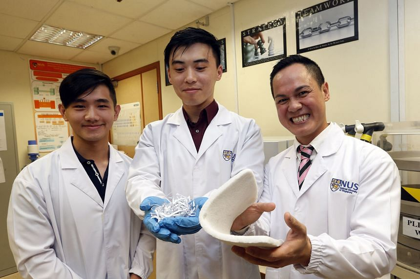 The NUS team led by Dr Duong (right) has converted paper waste into a novel material that could be used for oil spill clean-ups, heat insulation and packaging. The material will hit the market in May. With Dr Duong are (from left) mechanical engineering s