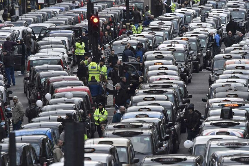 London's famous black cabs choking the city's streets as the cabbies protested against Uber in central London on Wednesday. The cabbies are crying foul because they feel that while they are subject to strict regulations, drivers for the ride-calling
