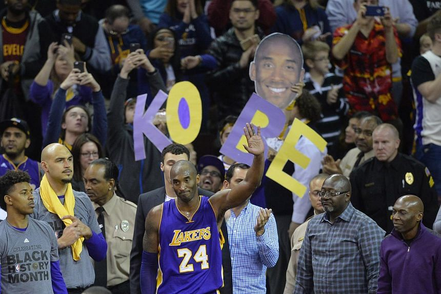 Los Angeles Lakers forward Kobe Bryant (centre) waves to the crowd near the end of a 120-111 loss to the Cleveland Cavaliers at Quicken Loans Arena on Feb 10, 2016.