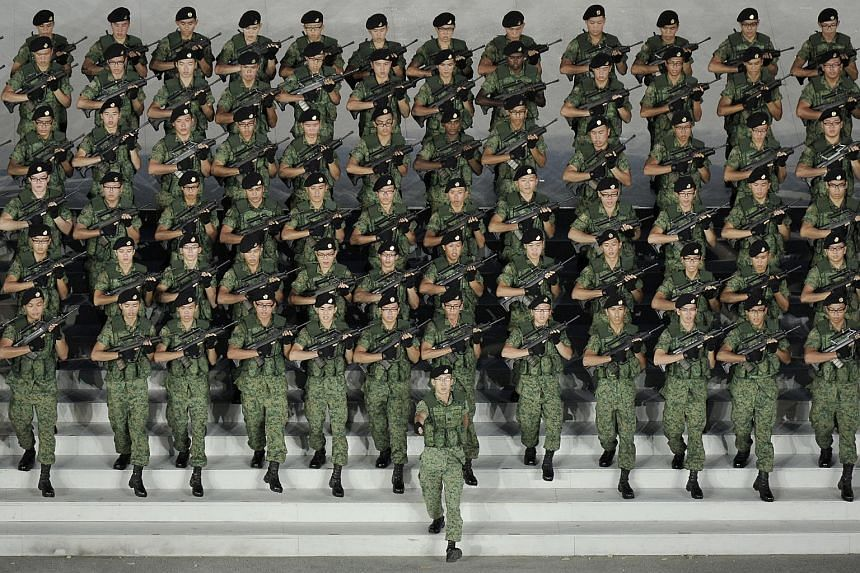 Soldiers marching down the steps of the Marina Bay Floating Platform during the National Day Parade (NDP) at Marina Bay Floating Platform on Aug 9, 2011.