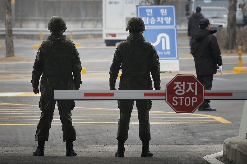 South Korean soldiers stand guard on the road leading to the Kaesong joint industrial zone near the DMZ dividing the two Koreas on Feb 11, 2016.