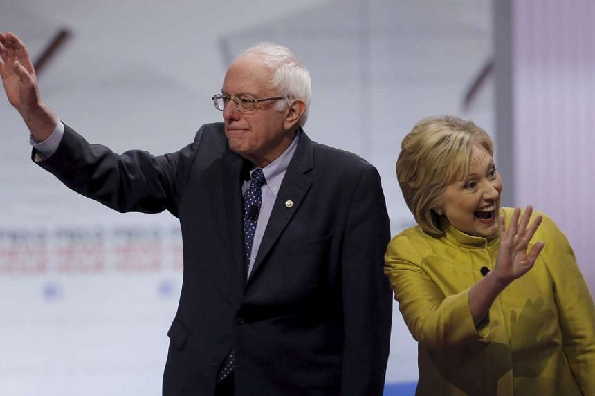 Democratic candidates Bernie Sanders and Hillary Clinton before of the start of their debate in Milwaukee, Wisconsin, on Feb 11.