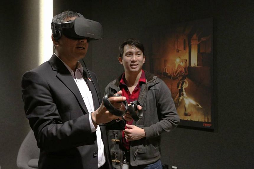 Foreign Minister Vivian Balakrishnan previews an Oculus virtual reality headset and controls on a visit to Facebook in Silicon Valley.