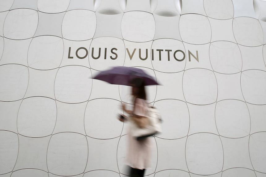 Louis Vuitton's Ginza boutique, designed by Japanese studio Aoki Jun, has an etched metal facade (above).