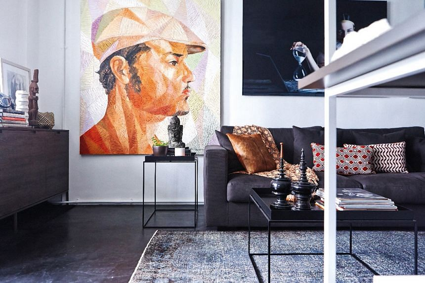 Photographs and art pieces line the walls.