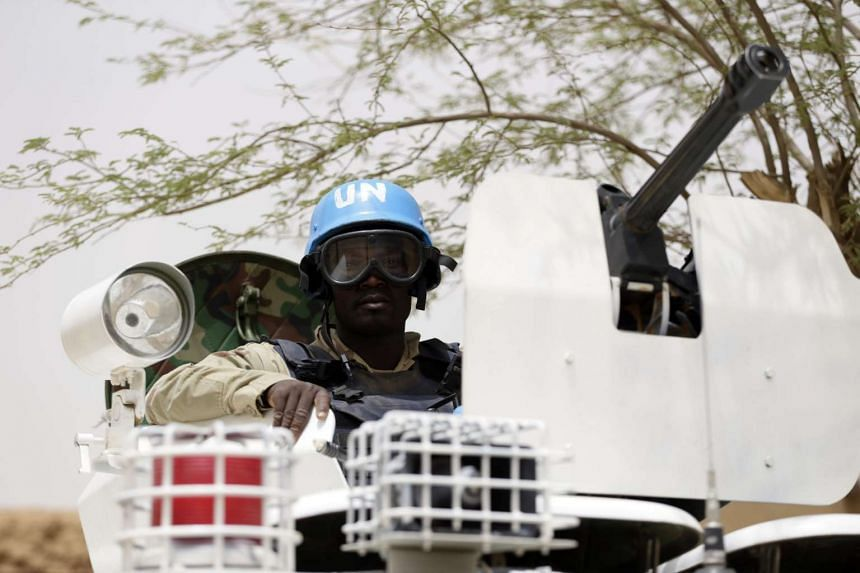 A file photo taken on July 27, 2013 shows United Nations (UN) soldiers patrolling in the northern Malian city of Kidal. At least five UN peacekeepers were killed on Feb 12, 2016.