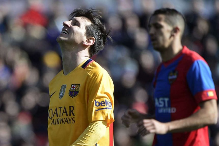 Barcelona's Argentinian forward Lionel Messi gestures after missing an attempt on goal during the Spanish league football match Levante UD vs FC Barcelona at the Ciutat de Valencia stadium in Valencia on Feb 7, 2016.