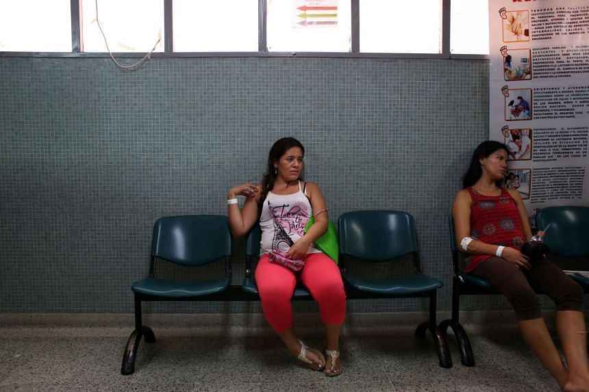 A pregnant woman waits to be seen by a doctor at the E.S.E Hospital Universitario Erasmo Meoz in Cucuta, Colombia.