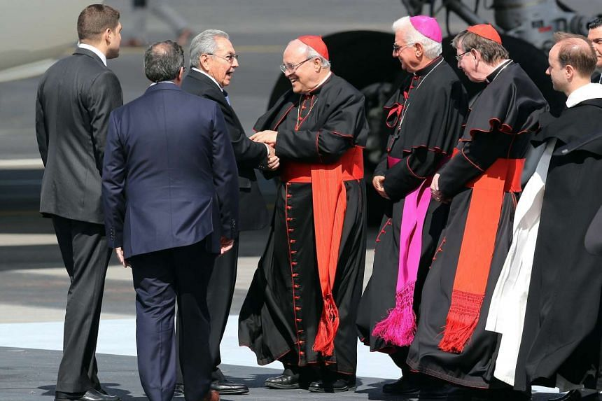 Cuban President Raul Castro (centre-left) greets the Cuban Cardinal Jaime Ortega (centre-right) and other priests before the arrival of the Pope Francis at Jose Marti airport in Havana, Cuba on Feb 12, 2016.