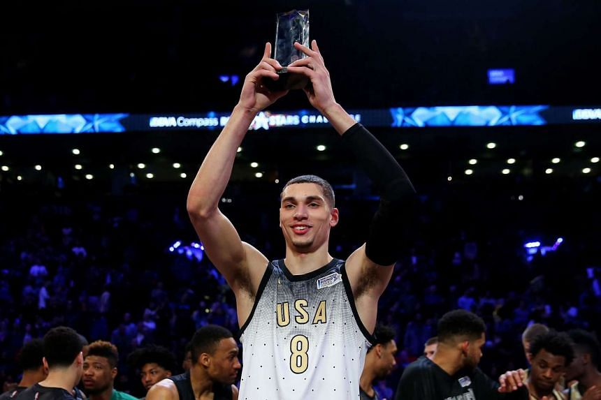 Zach LaVine holds up the MVP trophy after the win against the World Team.