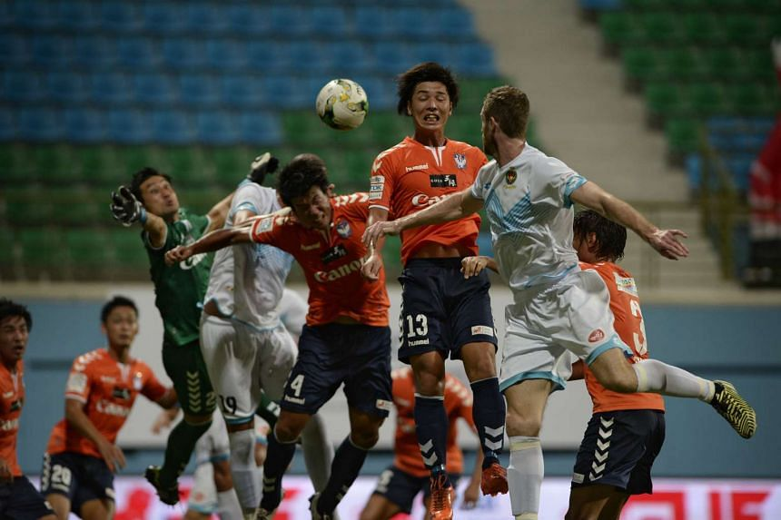 Atsushi Kawata (no 13) of Albirex Niigata FC tries to head the ball away during the match against Brunei DPMM on Feb 13, 2016.