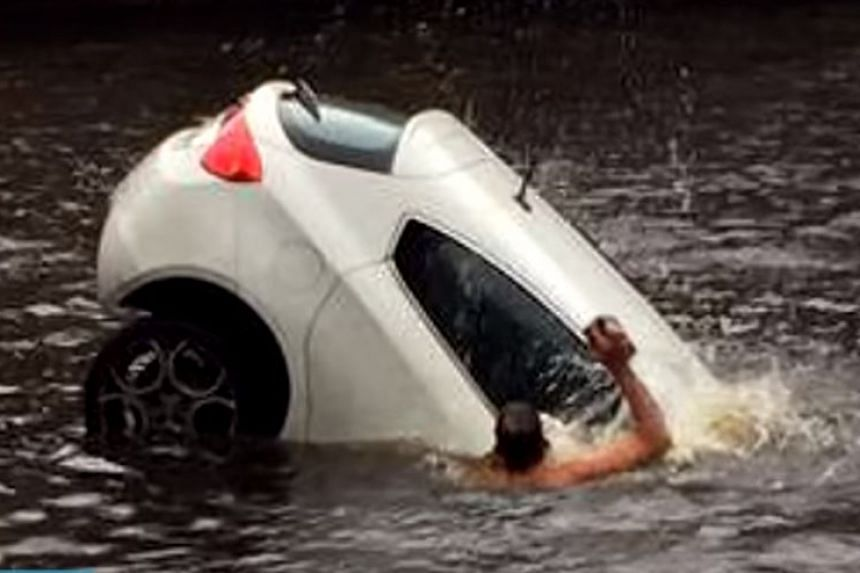 Four men jumped into an Amsterdam river to save a mother and toddler from a sinking car in Feb, 2016.