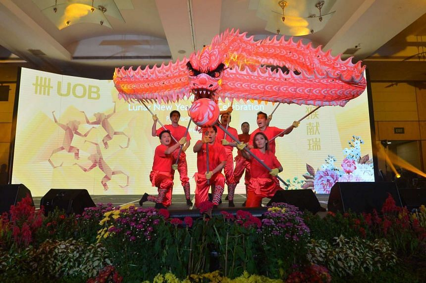 UOB staff perform a dragon dance at the event.