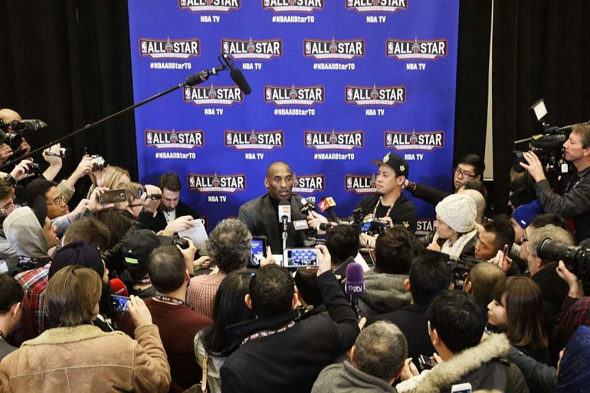 Los Angeles Lakers player Kobe Bryant (centre) talking to reporters in Toronto, Canada, on Feb 12, 2016.