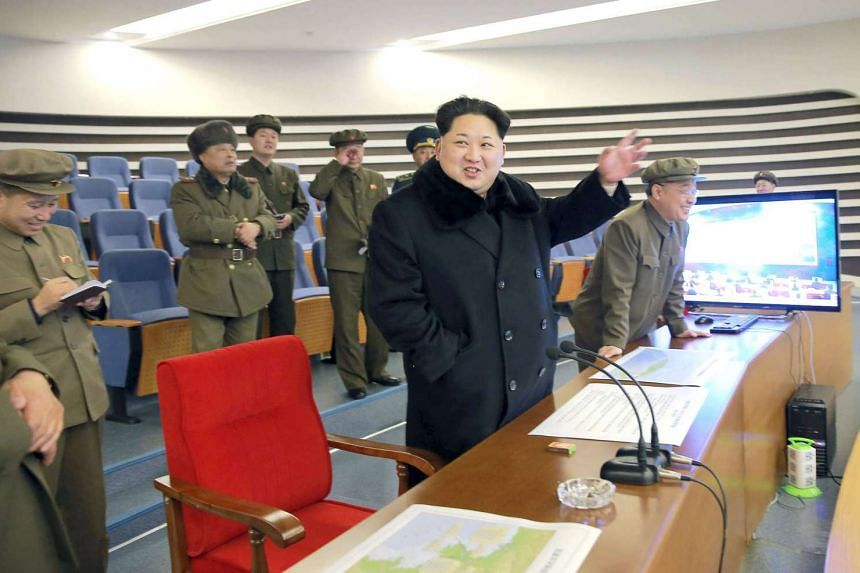 North Korean leader Kim Jong Un (centre) reacting as he watches a long range rocket launch in North Korea, in this photo released by Kyodo on Feb 7, 2016.
