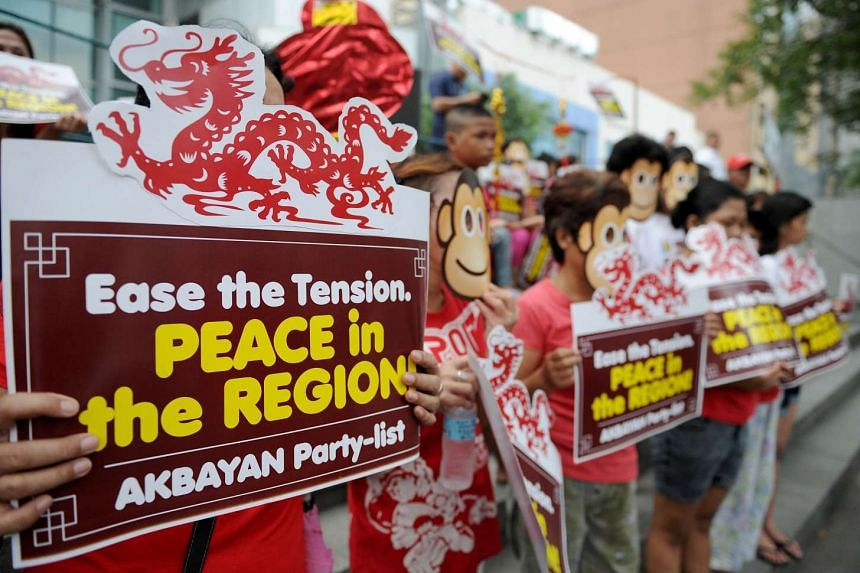 Activists wearing monkey masks during a rally against Beijing's island-building in the South China Sea, ahead of the Lunar New Year, at the Chinese consulate in Manila on Feb 5.