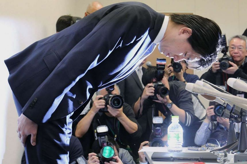 Lawmaker Kensuke Miyazaki bowing during yesterday's press conference, where he admitted to having a sexual encounter with a bikini model several days before his wife gave birth to their first child.