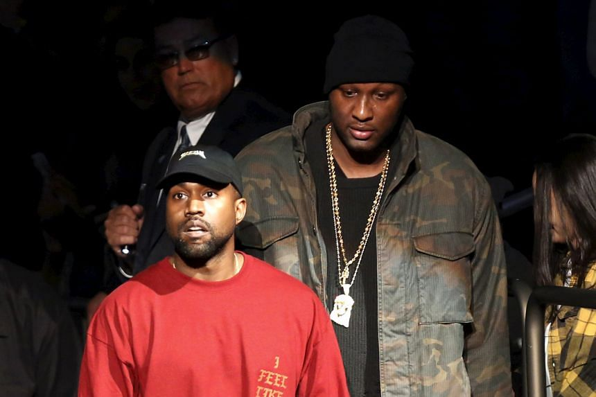 Rapper and fashion designer Kanye West (left) arriving for the Yeezy Season 3 presentation and release of his new album during New York Fashion Week with Lamar Odom.