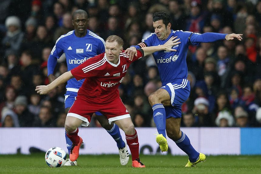 Ex-Manchester United player Paul Scholes (centre) in action in a charity game at Old Trafford last year. In his current role as a pundit, Scholes has criticised United's playing style under current manager Louis van Gaal.