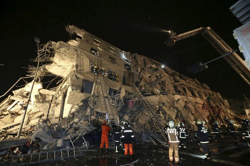 Rescue personnel working at a damaged building after an earthquake in Tainan, Taiwan, on Feb 6, 2016.