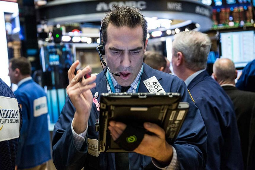 Traders work on the floor of the New York Stock Exchange on Feb 12, 2016 in New York City.