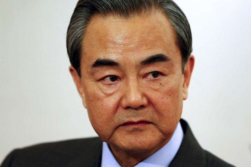 China's Foreign Minister Wang Yi answering a reporter's question during a Reuters interview in Munich, Germany, on Feb 12, 2016.