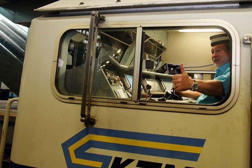 The Sultan of Johor in the driver's seat of a train on Sunday (Feb 14), driving it from JB Sentral station to Segamat.