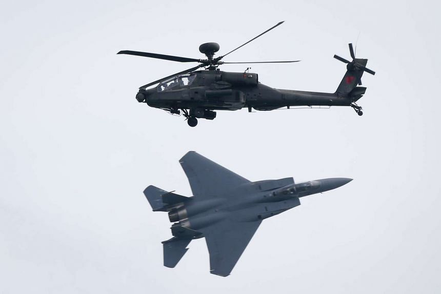 An RSAF F-15SG and a AH-64D performing an integrated display during a preview show, on Feb 14, 2016.