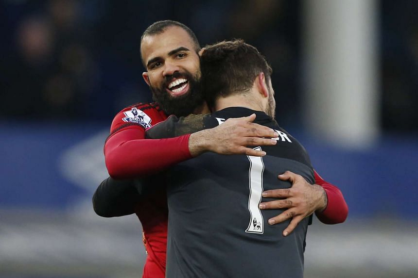 West Brom's Sandro and Ben Foster celebrate at the end of the match.