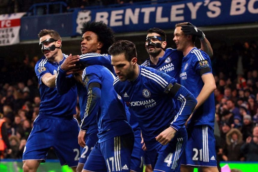 Chelsea players celebrate after a goal.