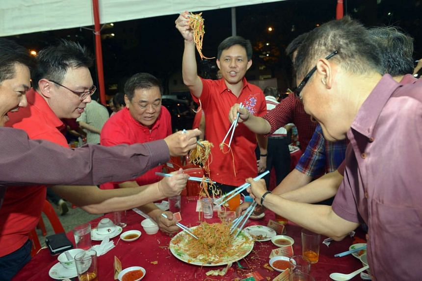 Mr Chan Chun Sing tossing yusheng with residents of Tanjong Pagar GRC and Radin Mas SMC during their annual Chinese New Year dinner, on Feb 14, 2016.