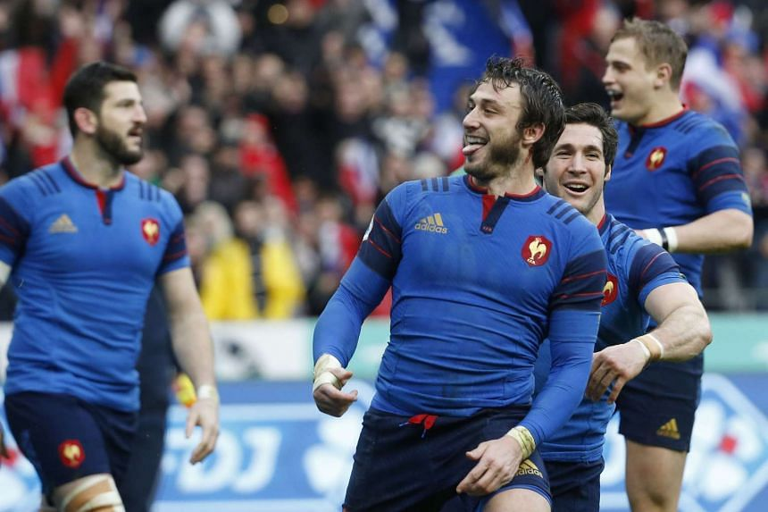 France's fullback Maxime Medard celebrates after scoring a try.