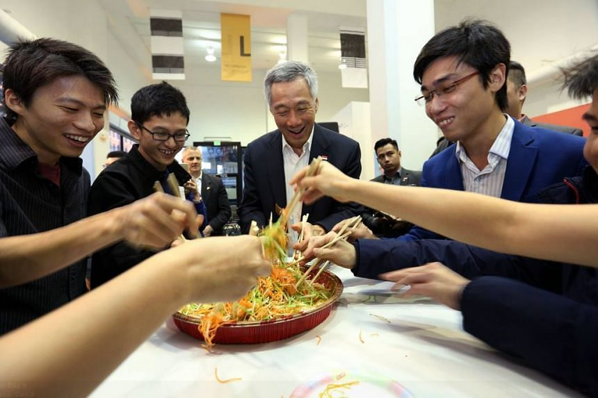 "Mr Lee tossing ""lo hei"" with Singaporean tech professionals."