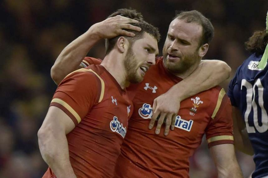 Wales' George North is congratulated on his try in the round two match between Wales and Scotland.