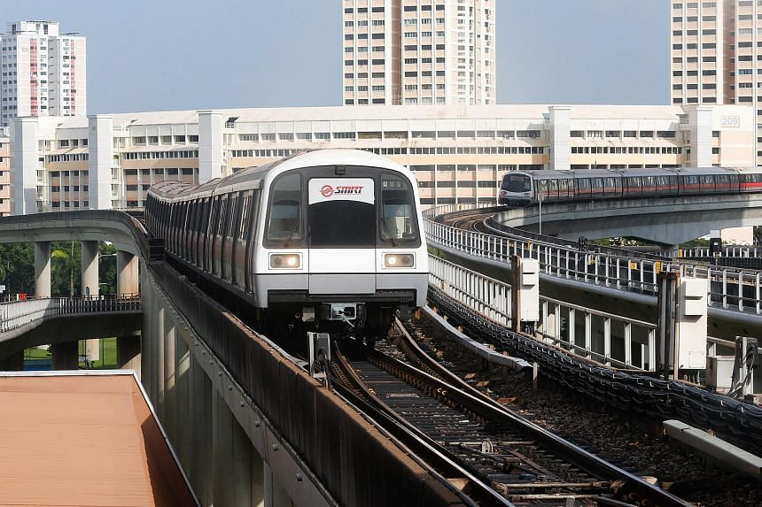 Trains waiting to move into Jurong East MRT station on Dec 30, 2015.