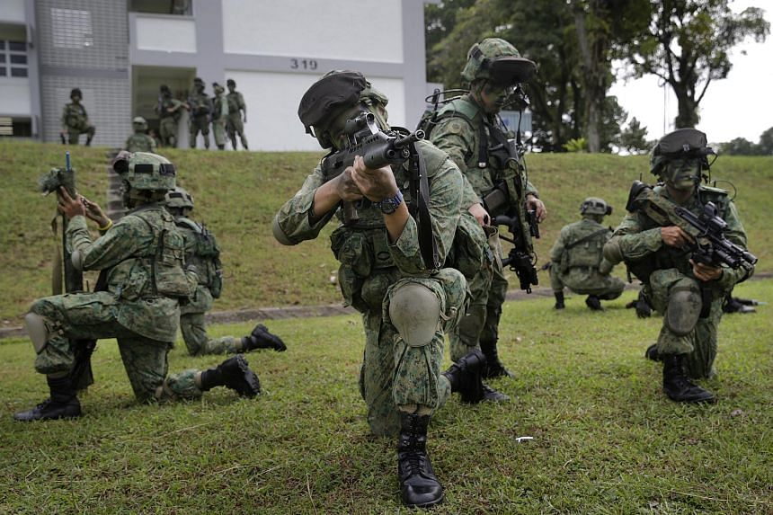 Soldiers preparing for a drill during the Singapore Army's Standby Force activation exercise on Nov 26, 2015.