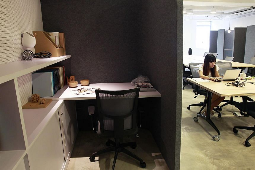 A coworking desk in a booth at The Co, a coworking space in High Street.