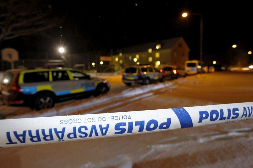 Swedish police cordoning off an asylum centre in Ljusne, in northern Sweden, after a fatal stabbing incident, on Feb 13, 2016.
