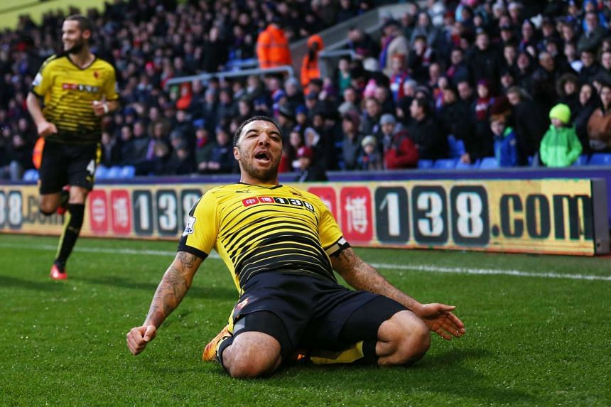 Troy Deeney celebrates after scoring the second goal for Watford.