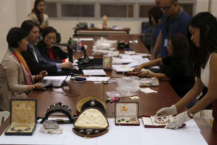 An official displays some of the confiscated jewellery of former Philippine first lady Imelda Marcos.