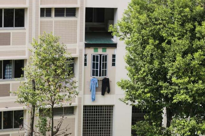 The fourth-storey flat at Block 542, Serangoon North Avenue 4 where three-year-old Nur Syahamah Syahrom fell out from.