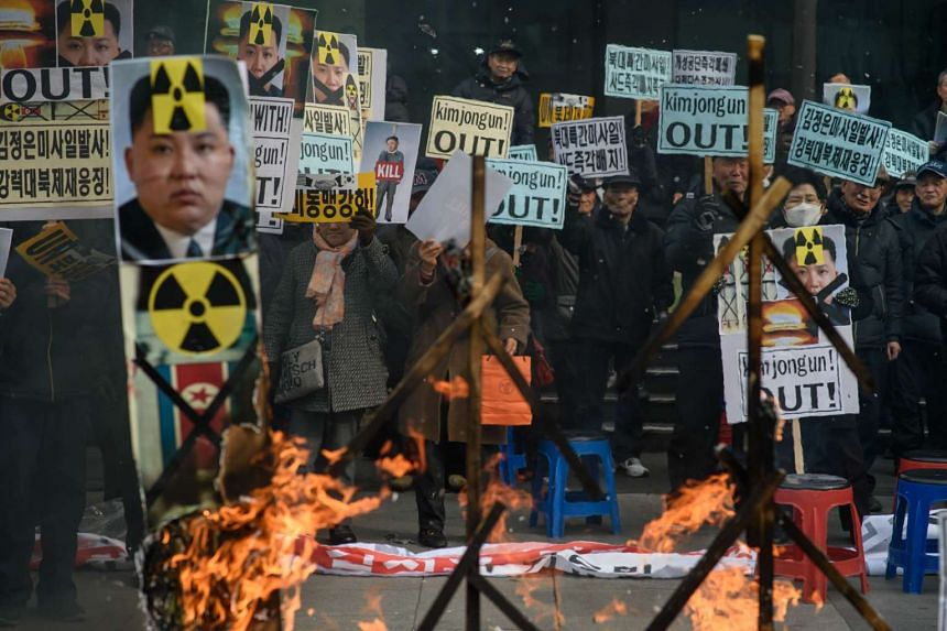 Anti-North Korean activists protesting against the latest nuclear test and rocket launch by Pyongyang, in Seoul on Feb 11, 2016.