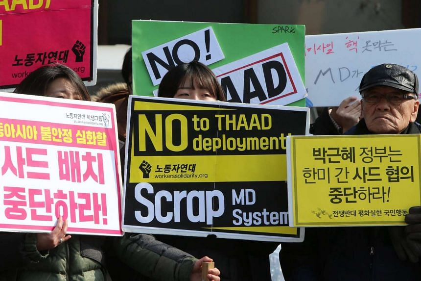 South Koreans protest the possible deployment of an advanced US antimissile defence system in Seoul on Feb 11, 2016.
