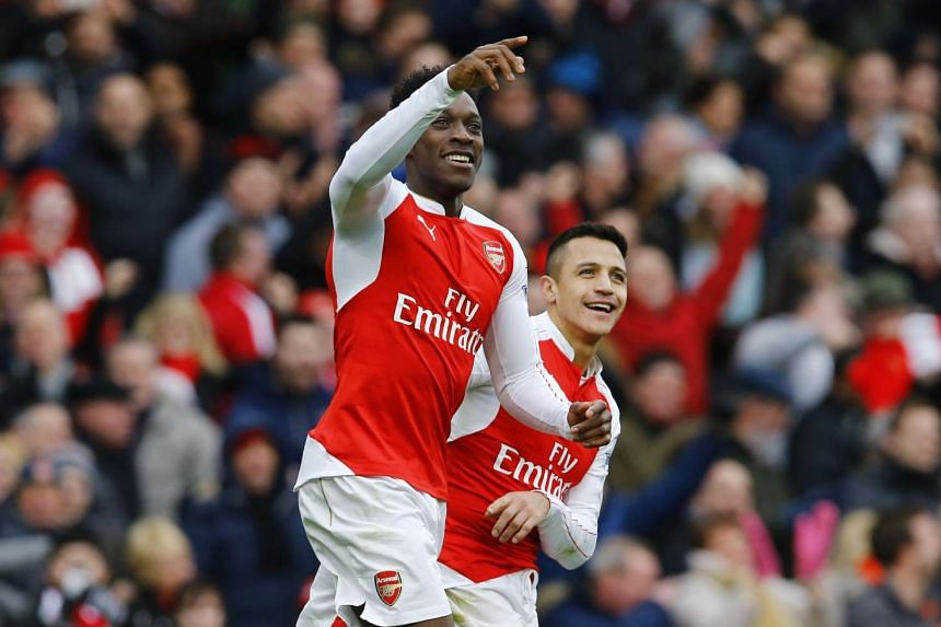 Danny Welbeck celebrates scoring the second goal for Arsenal at the Emirates Stadium on Feb 14, 2016.