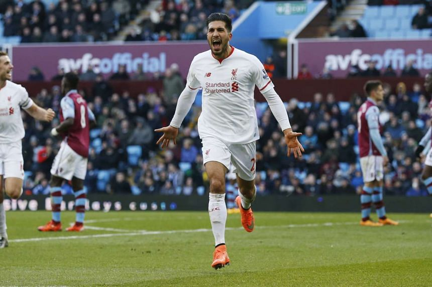 Emre Can celebrates scoring the third goal for Liverpool at the Barclays Premier League in Villa Park on Feb 14, 2016.
