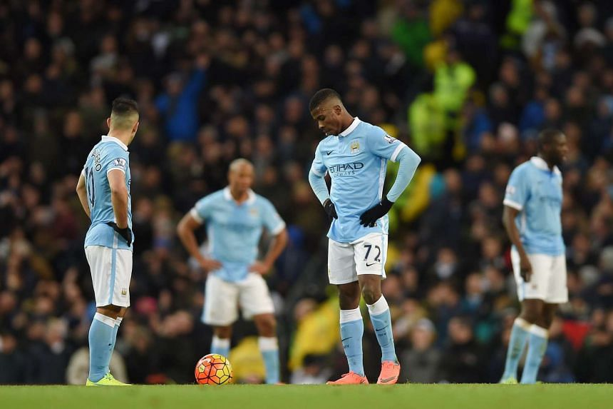 Manchester City's Sergio Aguero (left) and Kelechi Iheanacho (centre) react after Tottenham Hotspur's Christian Eriksen scores the 2-1 goal during the English Premier League soccer match at the Etihad Stadium, Manchester, Britain, on Feb 14, 2016.
