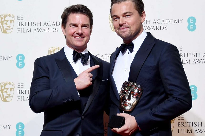 Leonardo DiCaprio (right) poses with Tom Cruise in the press room after winning the award for Best Actor for The Revenant during the 69th annual British Academy Film Awards at the Royal Opera House in London, Britain, on Feb 14, 2016.