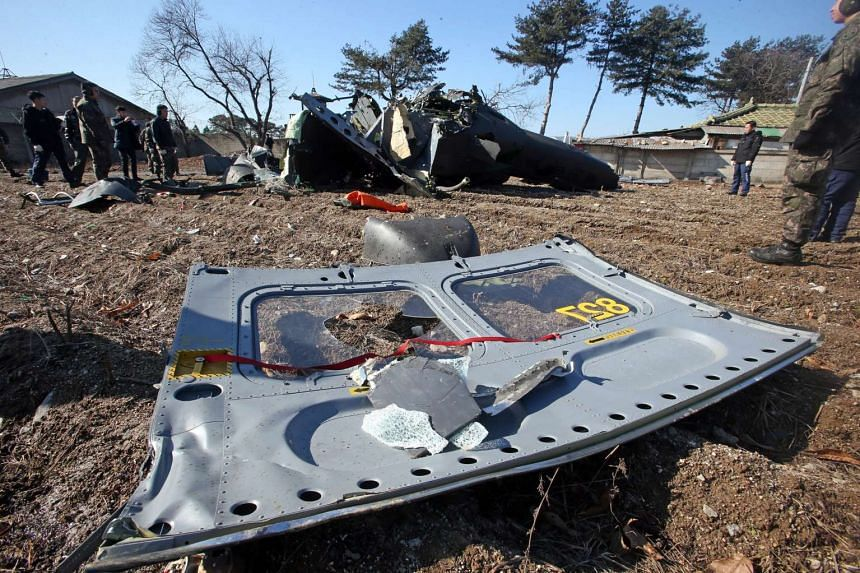 Debris from an army helicopter crash close to a civilian farm in Chuncheon, Gangwon province in South Korea, on Feb 15, 2016, during an inspection flight.